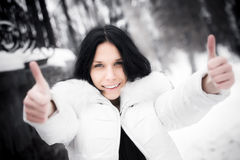 Happy woman showing excellent handsign. Winter season Royalty Free Stock Image