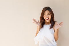 Happy woman showing exciting positive expression. With blank background, warm tone brown beige color Royalty Free Stock Image