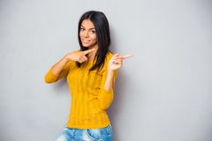 Happy woman showing finger away Stock Images