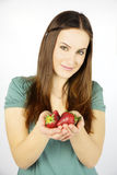 Happy woman showing fresh strawberry Royalty Free Stock Image