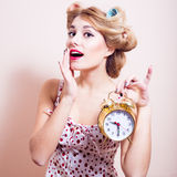 Happy woman showing golden alarm clock portrait Royalty Free Stock Photo
