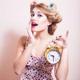Happy woman showing golden alarm clock portrait Royalty Free Stock Photo