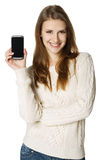 Happy woman showing her mobile phone Stock Photo