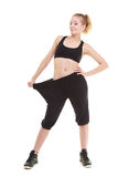 Happy woman showing how much weight she lost, big pants Stock Photography