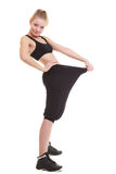 Happy woman showing how much weight she lost, big pants Royalty Free Stock Photos