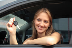 Happy woman showing key of a new car Royalty Free Stock Image