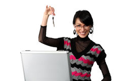 Happy woman showing keys from the suitcase Royalty Free Stock Image