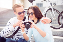 Happy woman showing photos to man Stock Images