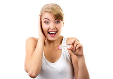 Happy woman showing pregnancy test with positive result Royalty Free Stock Image