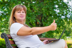 Happy woman   showing a sign of satisfaction Stock Photography