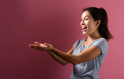 Happy woman showing something with her hands Stock Photos