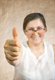 Happy woman showing thumb up Stock Photography