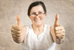 Happy woman showing thumb up Royalty Free Stock Photo