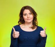 Happy woman showing thumbs up gesture Royalty Free Stock Photo