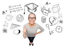 Happy woman showing thumbs up over school doodles Royalty Free Stock Images