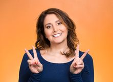 Happy woman showing victory sign Stock Photos