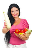 Happy woman showing zucchini Royalty Free Stock Photography