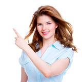 Happy woman shows a finger in the side. royalty free stock images