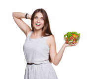 Happy woman shows fresh vegetable salad isolated on white Royalty Free Stock Photo