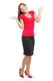 Happy woman shrugging. Shrugging happy woman in red outfit smiling at camera. Happy smiling full body portrait of a beautiful mixed Chinese Asian / Caucasian Stock Images