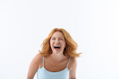 Happy woman with sincere smile. Joyful middle-aged lady is laughing from joke. She is standing and looking at camera with happiness. Isolated on background Royalty Free Stock Image