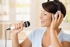 Happy woman singing at home Royalty Free Stock Photography
