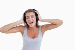 Happy woman singing while listening to music Stock Image
