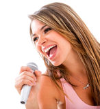 Woman singing with a microphone Stock Photo