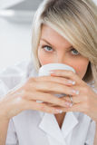 Happy woman sipping coffee in the morning Stock Image