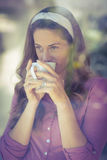 Happy woman sipping coffee Stock Images