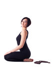 Happy woman sit in yoga meditation pose with beads Stock Photo