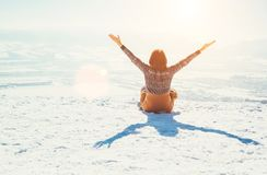 Happy Woman Sits On The Snowy Mountain Hill Over The City. Sunny Stock Images