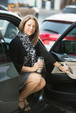 Happy Woman Sitting in Car Royalty Free Stock Photography