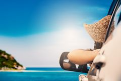 Happy woman sitting in the car and traveling summer season on the sea royalty free stock image