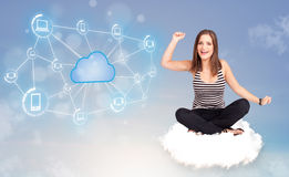 Happy woman sitting on cloud with cloud computing Stock Images