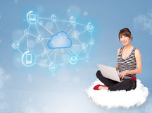 Happy woman sitting on cloud with cloud computing Stock Image