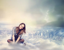 Happy Woman Sitting on the Clouds Stock Images