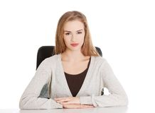 Happy woman sitting at the desk Stock Photo