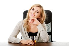 Happy woman sitting at the desk with cup of tea Stock Photo