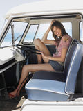 Happy Woman Sitting In Driver's Seat Of Van Stock Images