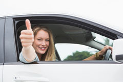 Happy woman sitting in drivers seat thumb up Stock Photo