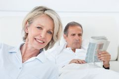 Happy Woman Sitting In Front Of Man Stock Images