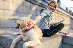 Woman sitting with dog. Happy woman sitting with golden retriever dog Stock Image