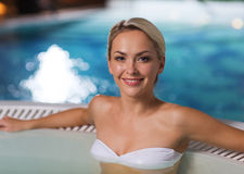 Happy woman sitting in jacuzzi at poolside Royalty Free Stock Photography