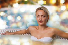 Happy woman sitting in jacuzzi at poolside Royalty Free Stock Image