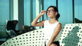 Happy woman sitting with laptop, lounge room stock footage