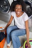 Happy Woman Sitting In Laundry Stock Photos