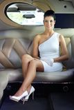 Happy woman sitting in limousine Royalty Free Stock Image
