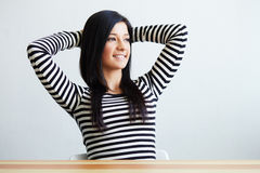 Happy woman sitting in office Stock Images