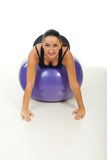 Happy woman sitting on pilates ball Royalty Free Stock Images